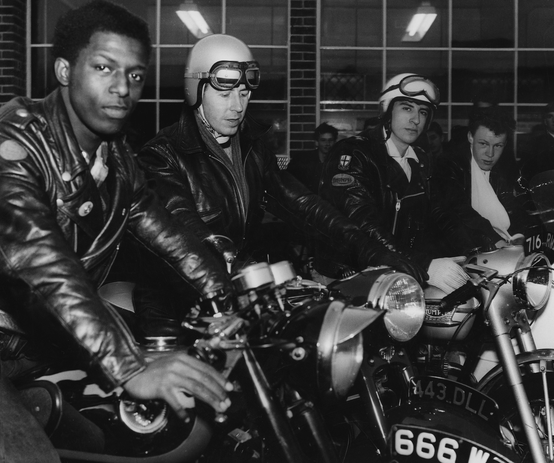 Group of bikers and rockers in leather jackets on the motorbikes at the Ace Cafe, London, 1960s from the 59 Club Archive