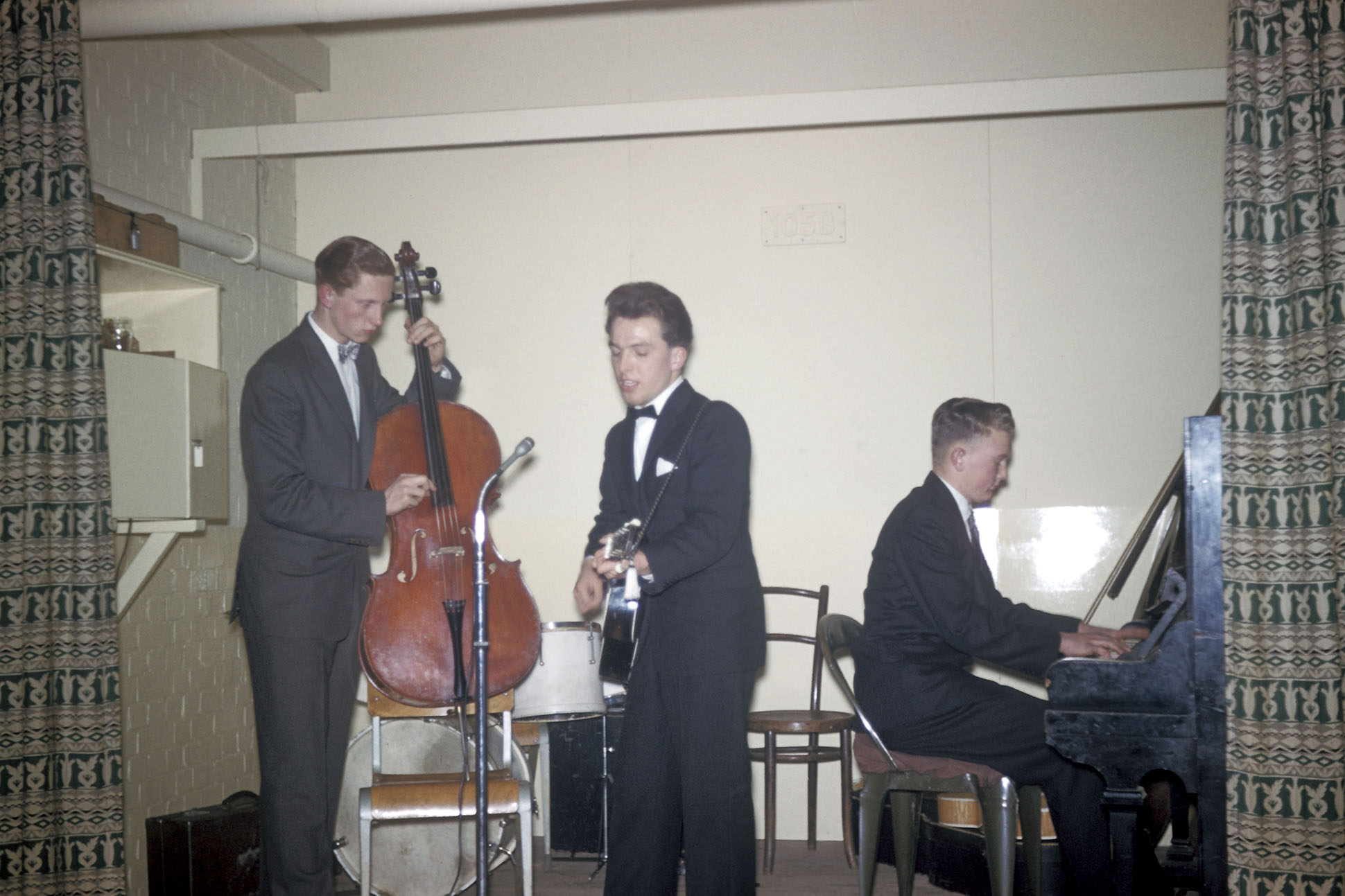 Three young men in a skiffle band with guitar, cello and piano playing a show, 1960 by Clare & Keith Laflin