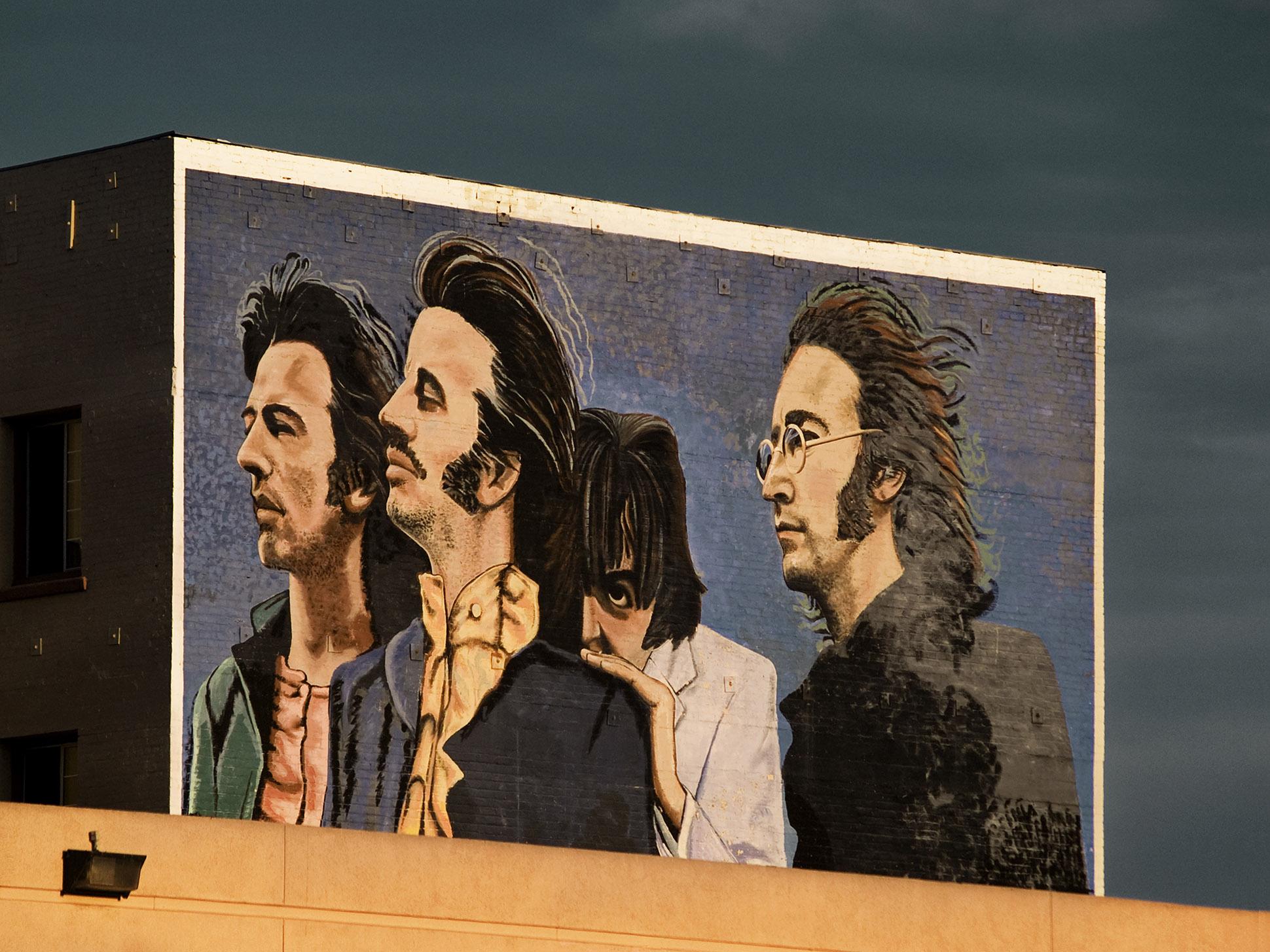 Graffiti mural of The Beatles (John Lennon, Paul McCartney, George Harrison and Ringo Starr) by Debbie Sears