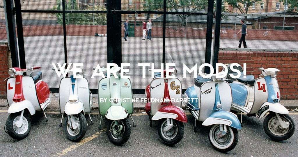 Vespa and Lambretta Italian scooters lined up with Mods in the background, London, 1990s by Rebecca Lewis