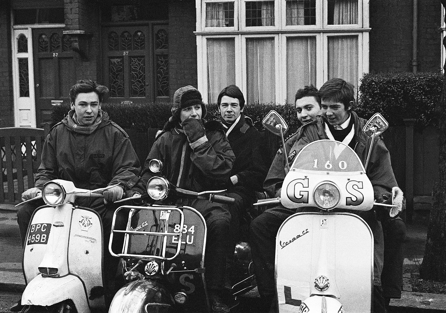 Teenage mods, modernists in parkas on their Vespa scooters during swinging sixties, London, 1964 by Peter Francis