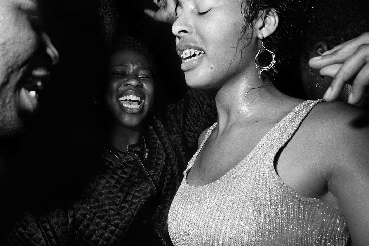 Jazz dancers at Acid Jazz night talking loud and saying something, Dingwalls, Camden, 1990s by Adam Friedman