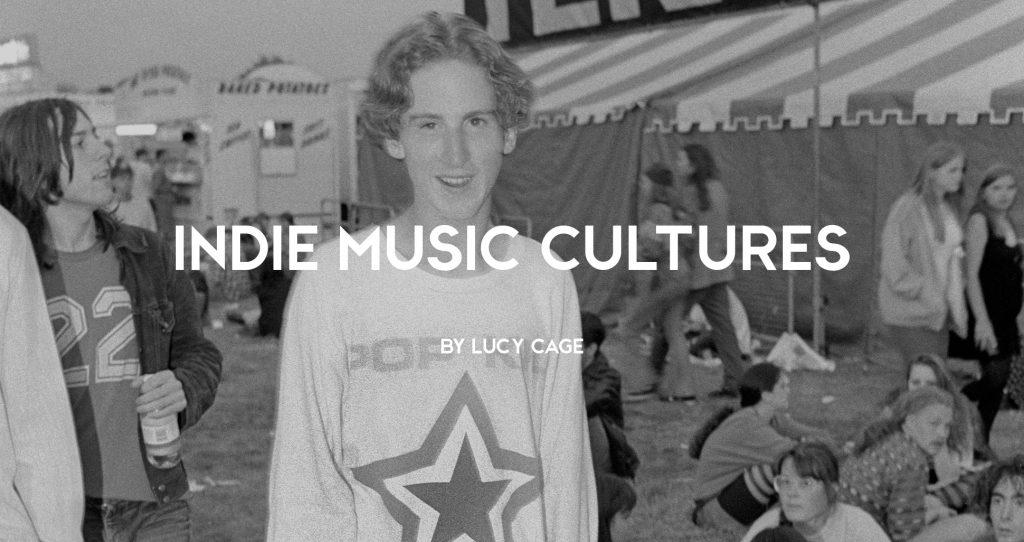Teenage indie fan wearing a long sleeve pop kid t-shirt outside the melody maker tent at a festival, 1990s by Dean Belcher