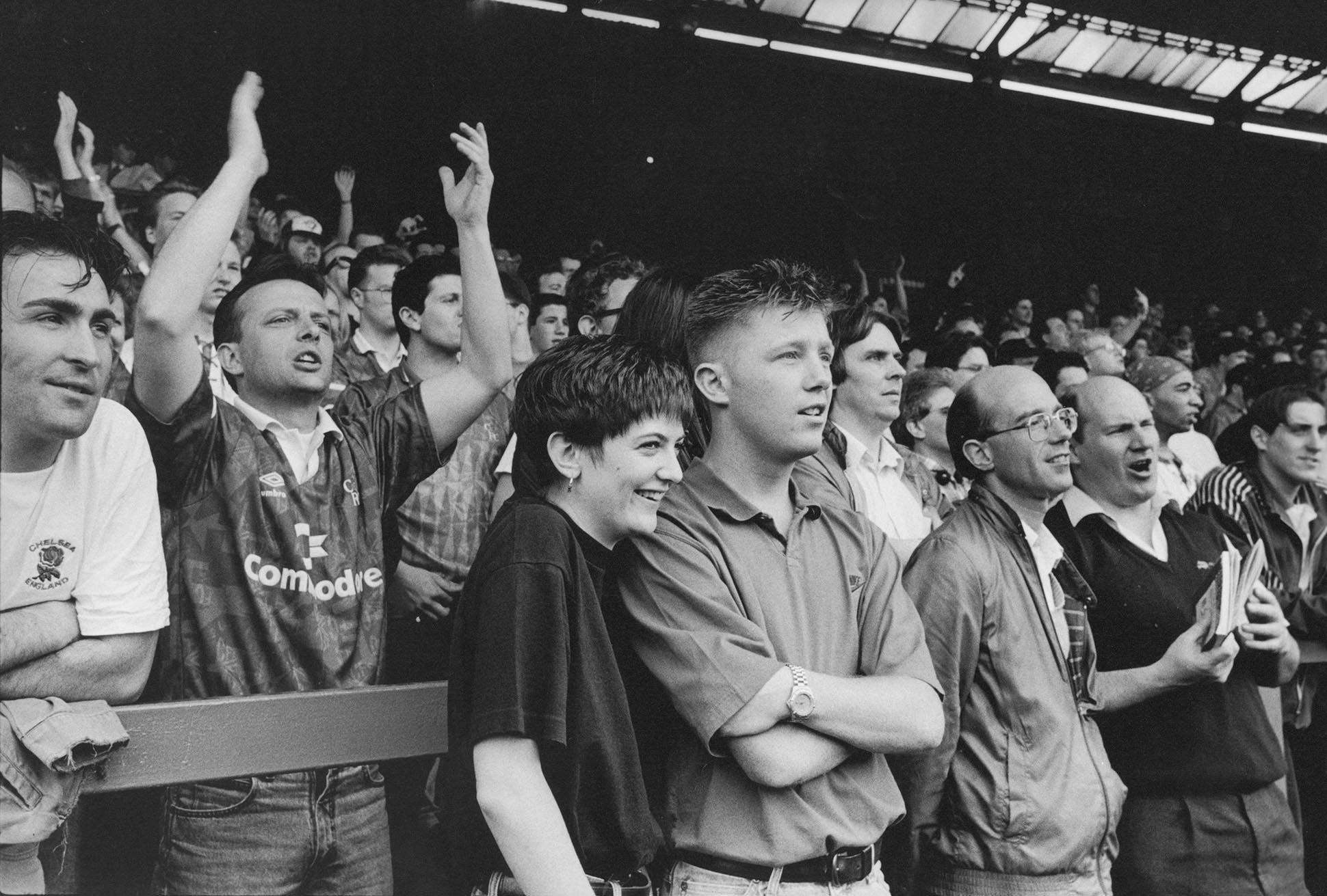 Football casual fans on the stands watching a football match, London, 1980s by John Ingledew