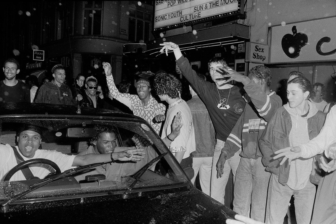 Ravers dancing outside acid house club 'The Trip' at Astoria during the Second Summer of Love, London, 1988 by Marcus Graham