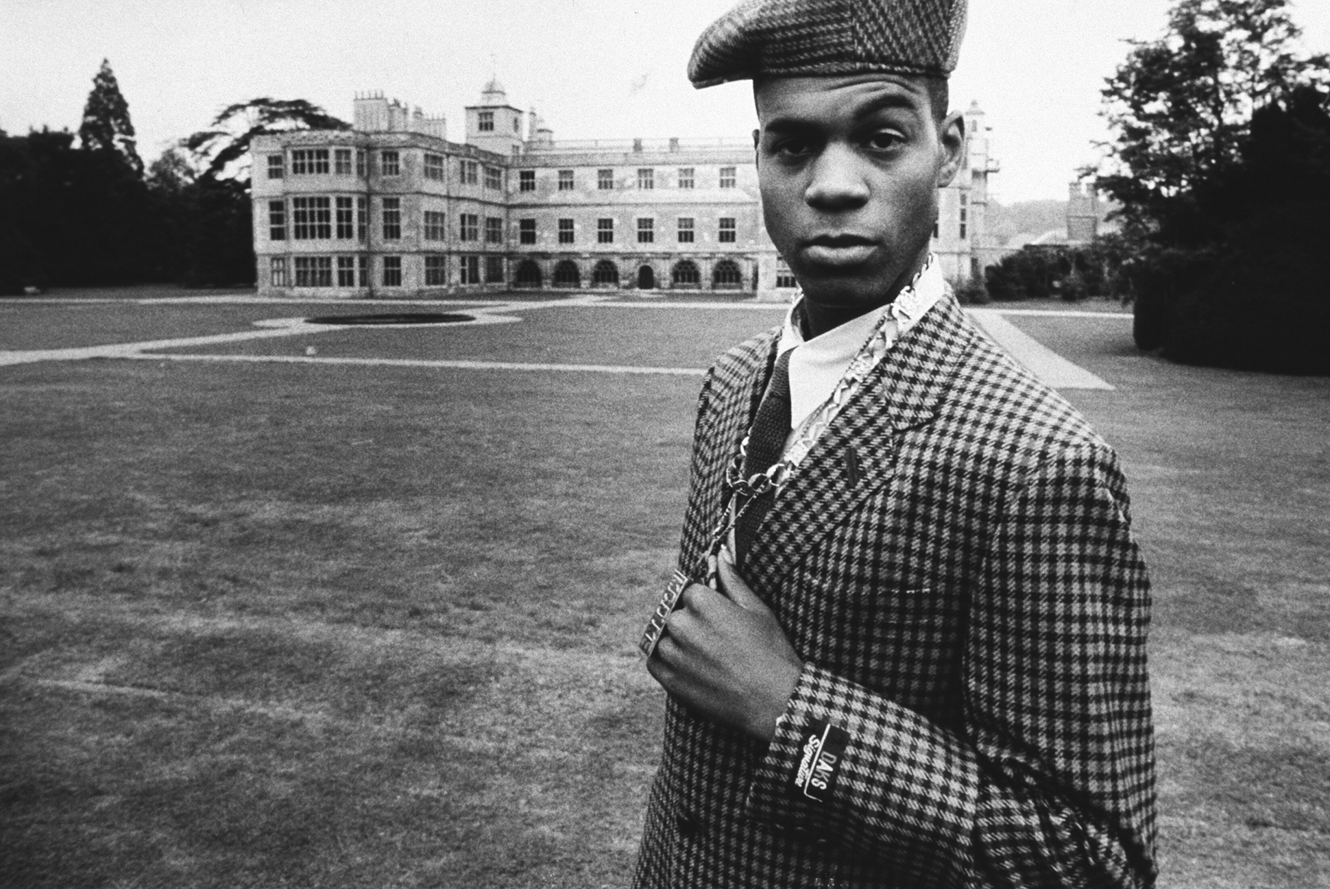 British Hip Hop artist MC Duke in a tweed suit outside a stately home, 1980s by Normski