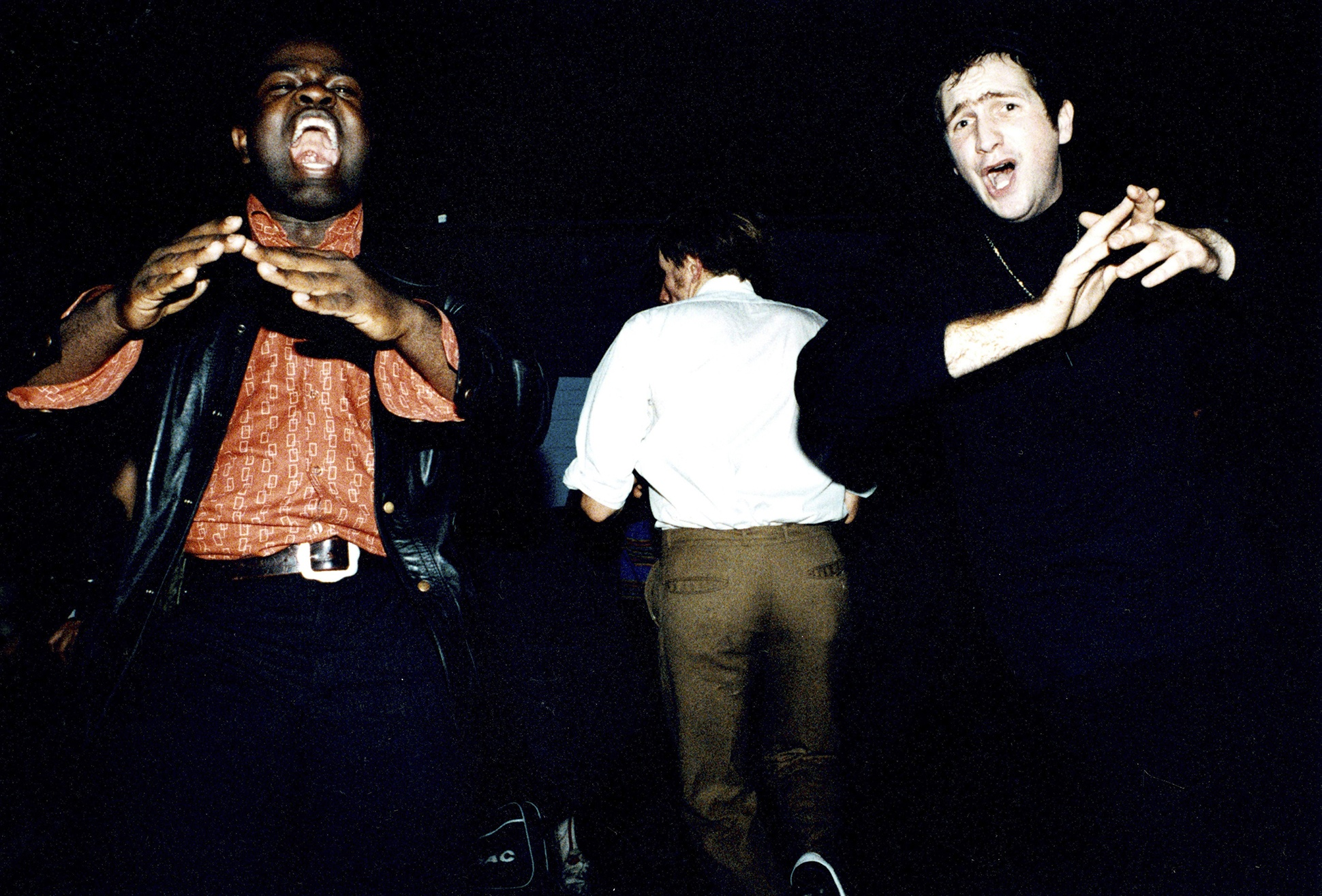 Two Northern Soul dancers clapping on the dance floor at an allnighter, London, 1990s by Rebecca Lewis