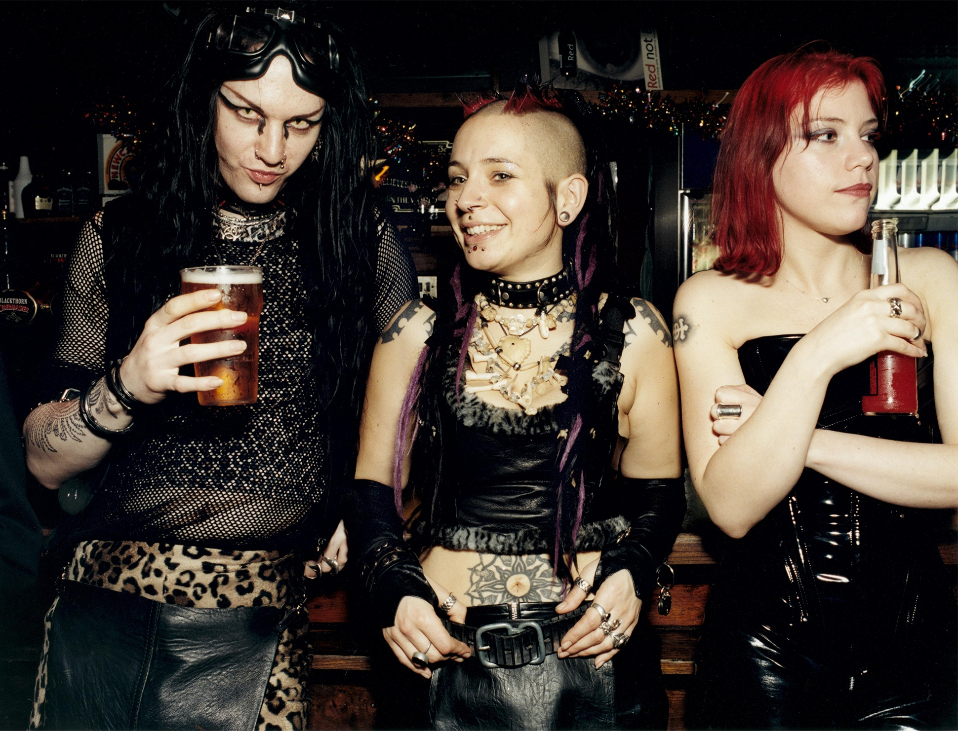 Cyber goths in latex and leather drinking in a pub in Brighton, 2001 by Rebecca Lewis