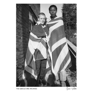 Two skinhead boys in Dr Martens draped in the union jack flag, High Wycombe, 1980s by Gavin Watson