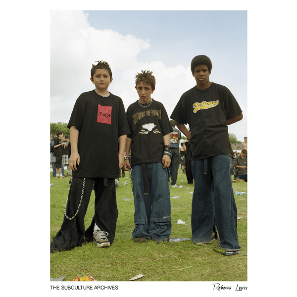 Three nu-metal boys in baggy jeans and band t-shirts (deftones, rage, cradle of filth) at Ozzfest by Rebecca Lewis