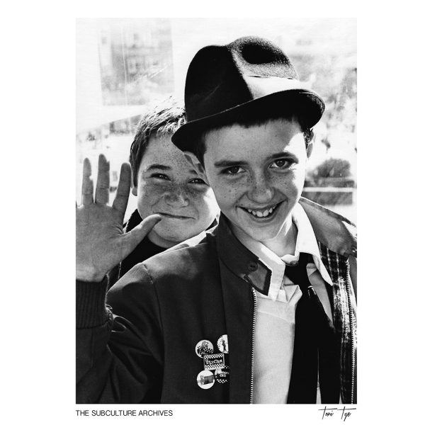 Two Ska, Two-Tone fans in a Harrington jacket, trilby hat and pin badges, 1980s by Toni Tye