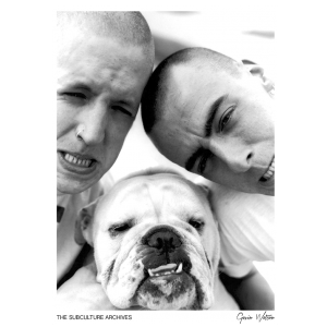 Two skinheads with buzzcuts pulling faces with a bulldog, High Wycombe, 1980s by Gavin Watson