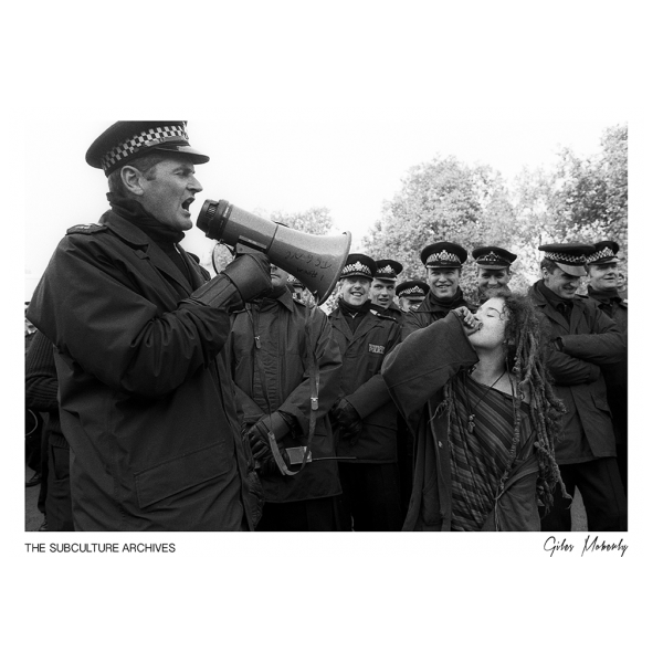 New age hippie protester mocking a police officer, Criminal Justice Act March, 1994 by Giles Moberly