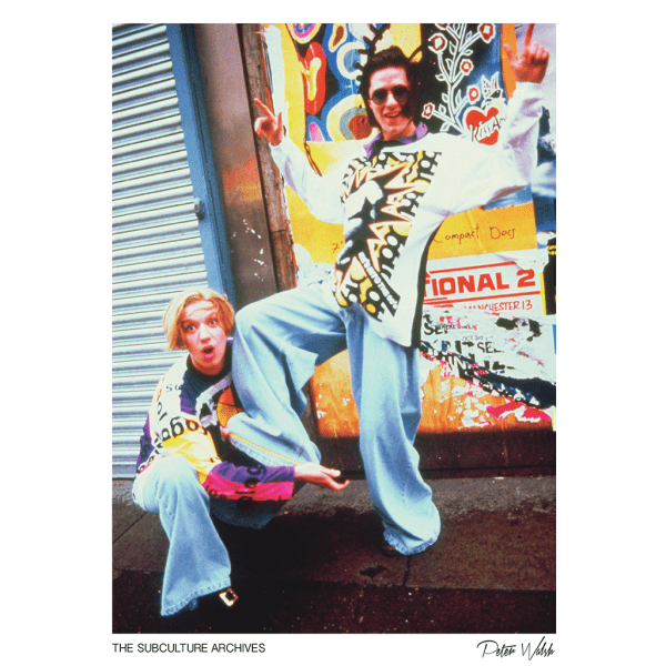Two Madchester acid house ravers in baggy Joe Bloggs clothes, Manchester, 1980s by Peter Walsh