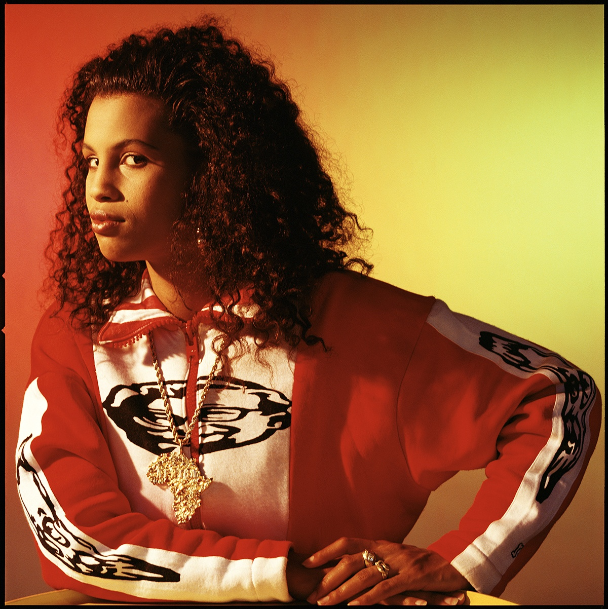 Portrait of Neneh Cherry with a gold Africa chain, London, 1980s by Laurence Watson