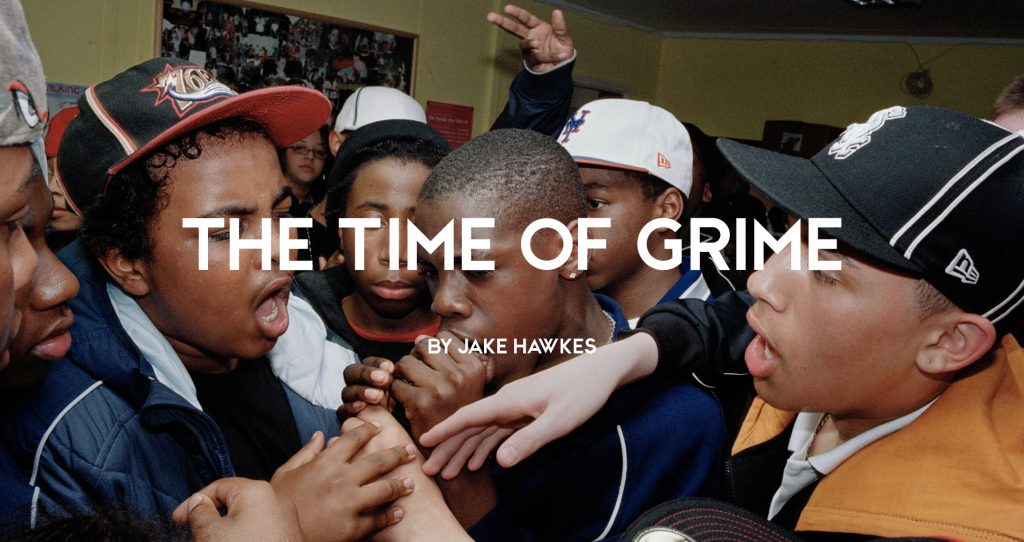 Group of teenage grime artists vying for the mic at a youth club, London, 2000s by Simon Wheatley